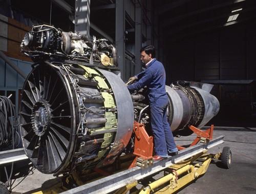 Maintenance engineer works on jet engine at the Marka airport in Amman Jordan.